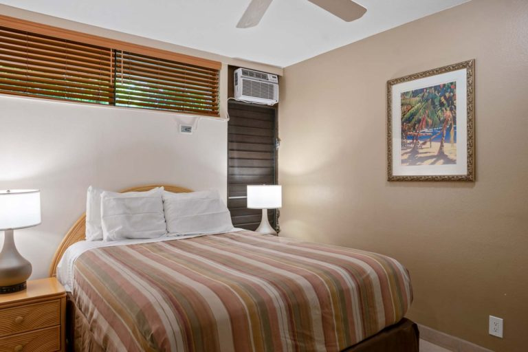 Photo of bedroom with queen size bed. Room 404