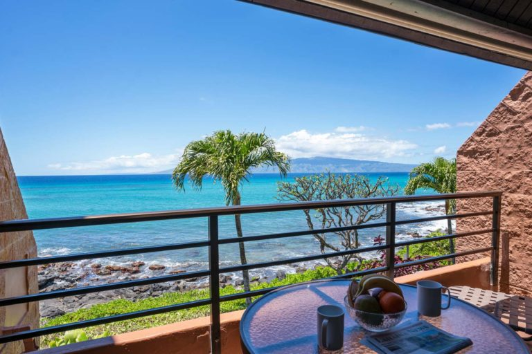 Photo of private patio and ocean view. Unit 412