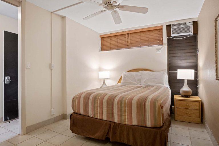 Photo of Bedroom with a queen size bed. Room 502 Ground Floor