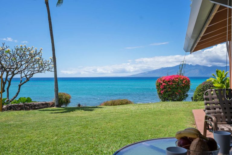 Photo of ground level private patio with ocean and Molokai island view. Room 107