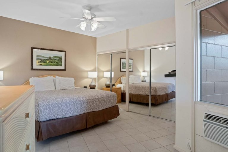 Photo of bedroom with a king size bed. Unit 210